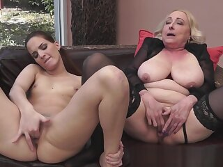 Granny orally pleasured close by X-rated stockings
